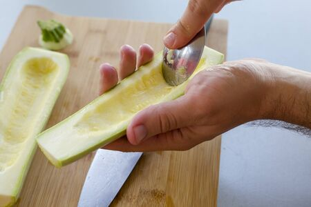 Preparing zuchini hands on the kitchen table