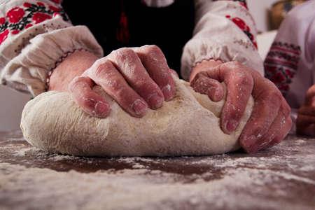 Kneading dough on table