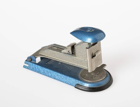 Antiquated stapler on white background