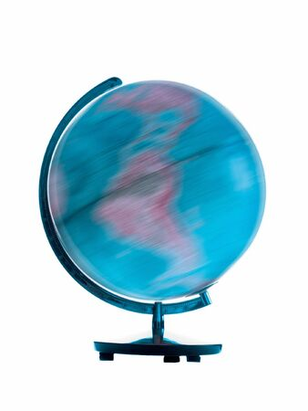 Spinning globe showing motion blur on white background photo