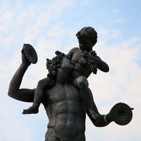 faun: Ancient bronze statue showing Faun and Bacchus