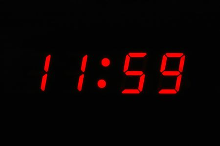 digital numbers: Almost Twelve Oclock - digital clock displaying 11 59  Stock Photo