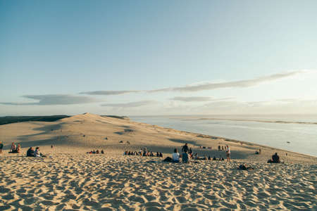 Panorama of the crowded Dune du Pilat at sunset