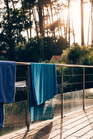 Towels getting drying at the sunset Фото со стока