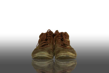 Old boots of brown color isolated on a white background. photo