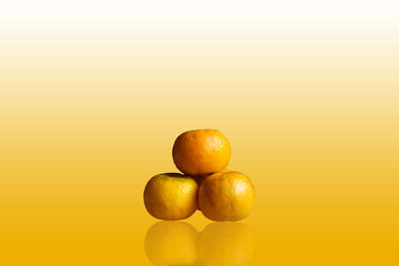 Three orange isolated on background Stock Photo