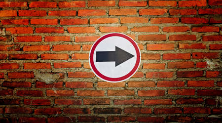 Traffic road sign isolated on wall  Stock Photo