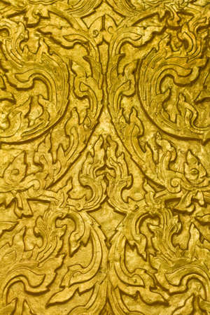 Buddha carved gold paint on temple door