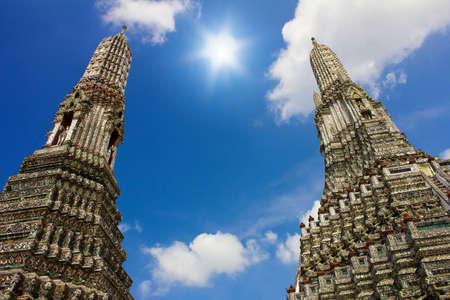 Wat Arun at the Bangkok , blue sky and sun Stock Photo