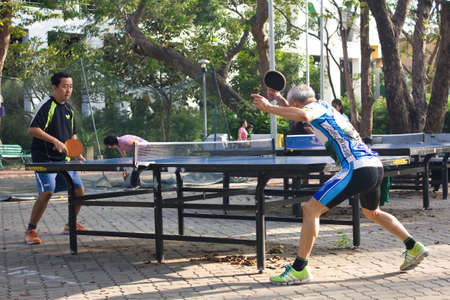 BANGKOK THAILAND - OCTOBER 27 : An unidentified two men playing table tennis on October 27,2011 at Suansaranrom Park in Bangkok,Thailand