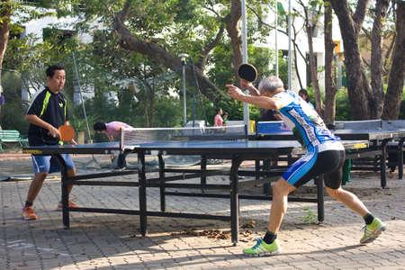BANGKOK THAILAND - OCTOBER 27 : An unidentified two men playing table tennis on October 27,2011 at Suansaranrom Park in Bangkok,Thailand Editorial