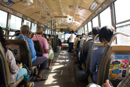 BANGKOK THAILAND - OCTOBER 27 :  Thai people on the regular  bus on October 27,2011 at  Bangkok ,Thailand Editorial