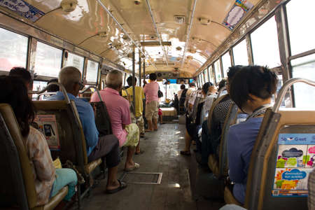 BANGKOK THAILAND - OCTOBER 27 :  Thai people on the regular  bus on October 27,2011 at  Bangkok ,Thailand Editorial