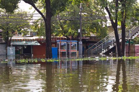 worst: BANGKOK, THAILAND - OCTOBER 30 : flooded street  during the worst flooding in decades on October 30,2011  Bangkok, Thailand. Editorial