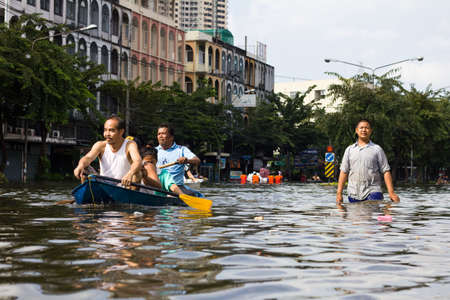 BANGKOK, THAILAND - OCTOBER 30 : People navigating the streets during the worst flooding in decades on October 30,2011  Bangkok, Thailand. Stock Photo - 11063819