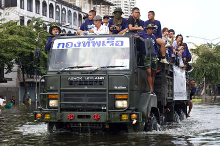 decades: BANGKOK, THAILAND - OCTOBER 30 : Rescue teams helping people to get home during the worst flooding in decades on October 30,2011  Bangkok, Thailand.