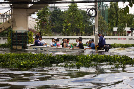 BANGKOK, THAILAND - OCTOBER 30 : Rescue teams helping people to get home during the worst flooding in decades on October 30,2011  Bangkok, Thailand.