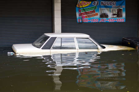 BANGKOK, THAILAND - OCTOBER 30 : Car swamping in flood water on October 30,2011  Bangkok, Thailand.