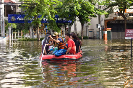 worst: BANGKOK, THAILAND - OCTOBER 30 : Rescue teams helping people to get home during the worst flooding in decades on October 30,2011  Bangkok, Thailand.