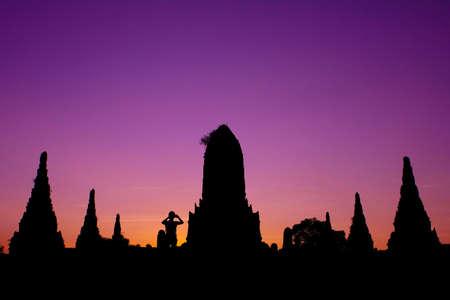 Silhouette of pagoda and man at Wat Chaiwattanaram Temple, Ayutthaya, Thailand
