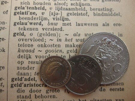 gulden: Dutch guilder on old Dutch dictionary Stock Photo