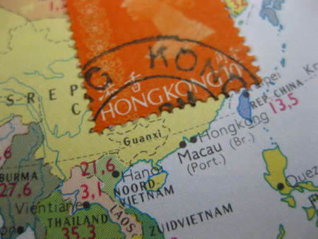 An old stamp from Hong Kong on a vintage map