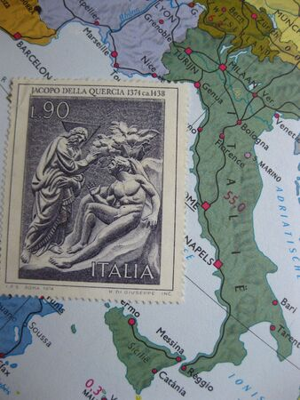 old Italian stamp on vintage map photo