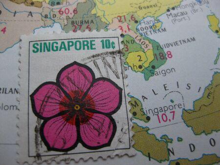 postal stamp: Singapore stamp on vintage map Stock Photo
