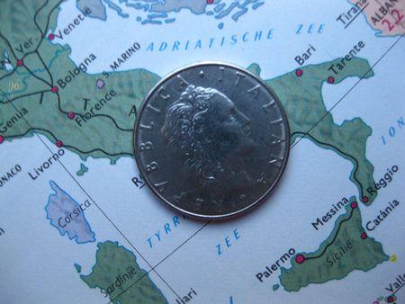 old Italian Lira on vintage Italian map photo