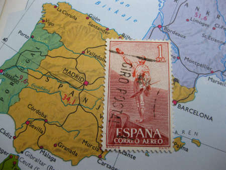 Stamp on Vintage map: Spain photo