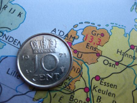 Coin on vintage map: 10 cent from Holland photo