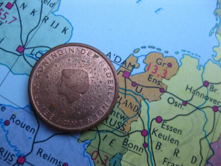 Coin on vintage map: 5 euro cent from the Netherlands photo