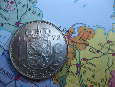 Coin on vintage map: dutch guilder Stock Photo
