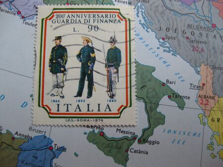Stamp on Vintage map: Italy photo