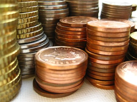 find us: Stack of coins from Canada and Europe