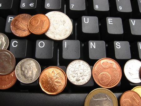 coins on a keyboard  photo