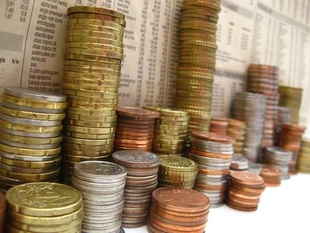 find us: stacks of coins with newspaper background Stock Photo