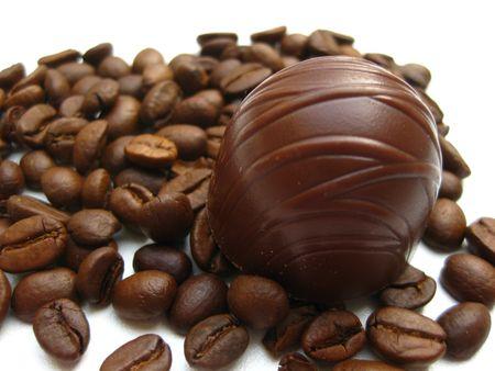 tea filter: Belgium Chocolate Praline on espresso beans Stock Photo