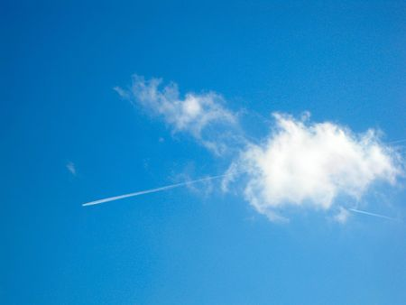 cloud drift: some contrails in a blue sky Stock Photo