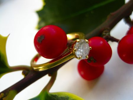 Diamond ring on holly berries photo