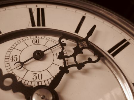 Detail of a vintage clock in sepia photo