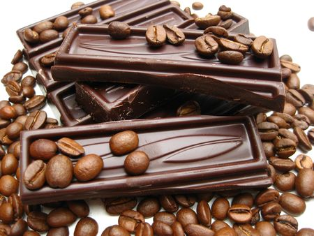 pieces of chocolate bar on coffee beans photo
