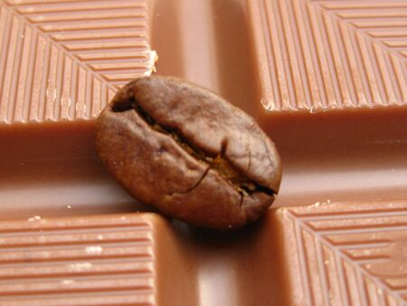 close up of a coffee bean on a chocolate bar photo