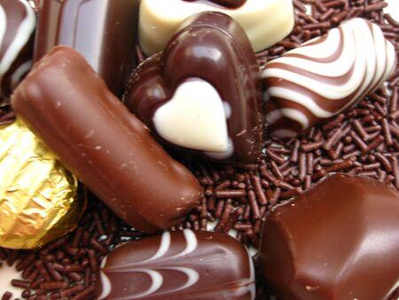 Belgium chocolate candies and milk chocolate on chocolate sprinkles Stock Photo - 3942222