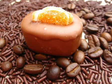 Belgium chocolate bonbon on beans and sprinkles photo