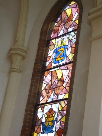 swaddling: Stained glass church window