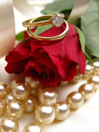 Wedding set on a red rose Stock Photo - 4206717