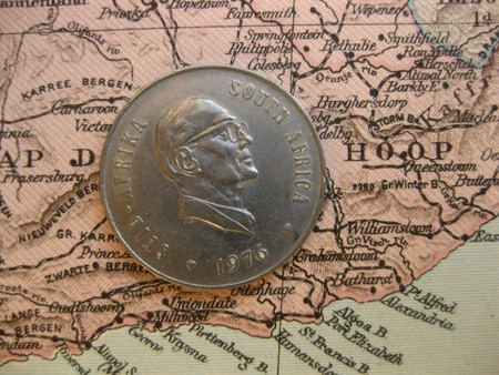 afrika: Coin on vintage map: South Afrika