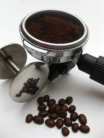 tamper: Espresso piston and tamper Stock Photo