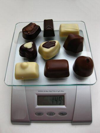 chocolates on a scale photo
